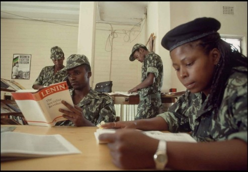 Laurie-Sparham_Umkhontowe'Sizwe-members-in-the-library-at-the-ANC-headquarters-in-Lusaka_1989.jpg